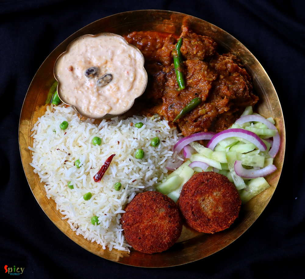 Pea pulao, Mutton curry, Fish chop, Salad, Payesh (rice pudding)