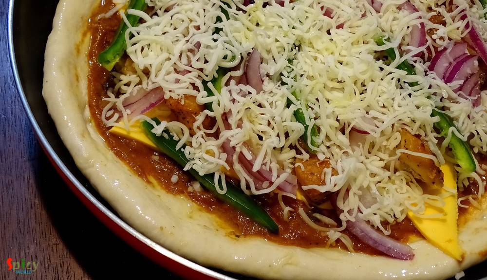 Cooking Step: Chicken Pizza with Makhni sauce